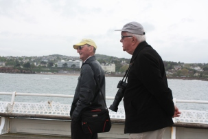 Our volunteer photographer Rodger, and model Paul, taking a stroll along Torquay Pier.